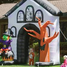 Inflatable Halloween Cat Archway by The Inflatable Howling Haunted House Hammacher Schlemmer
