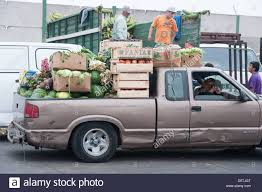 Worker Moving Vegetables In A Truck At Lo Valledor Central Wholesale ...