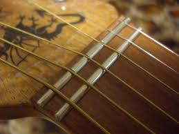 The First Zero Fret Has Just Strings Gliding Sliding Over It And Second Dedicated Cut Grooves Into To Guide