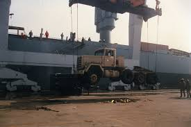 100 Two Ton Truck And A Half Ton Truck Being Loaded On The USNS DENEBOLA