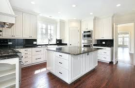 White Kitchens With Granite Countertops Kitchen Cabinets And Black Wood Flooring