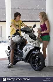 Teenagersboymotor Scootergirlentertainmentsmilepeoplefriendscoupleyoungsitstandlean Pillareye Contactfallen In Loveloveschoolpick Upthere