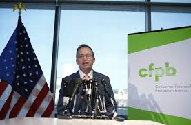us consumer protection bureau installed consumer agency sets hiring freeze halts