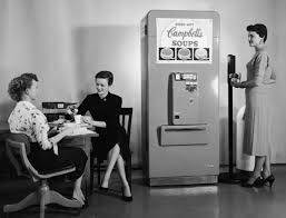 Three Women Enjoy Soup From A Campbells Vending Machine In Their Office 1950s