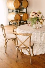Small Table Lace Linen Votives Florals Faux Wedding Party Styled Shoot Rustic Event Wood Barrels