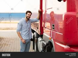 Handsome Truck Driver Image & Photo (Free Trial) | Bigstock How To Become A Truck Driver Cr England Why Drivers May Be Falling Asleep Injured By Trucker Legal Consequences Of Nonenglish Speaking Jeremy W Shortage Contuing Impact Chemical Supply Chains Life As Woman Transport America Military Veteran Driving Jobs Cypress Lines Inc Handsome Masculine Truck Driver Standing Outside With His Vehicle Indian Editorial Image Image Colorful 51488815 Police Search For Missing 22yearold Semi Local News Norma Jeanne Maloney From Complete Creative Control Prime On The Road Fitness 2014 Nascar Team Dean Mozingo Youtube