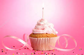 Tasty birthday cupcake with candle on pink background — Stock