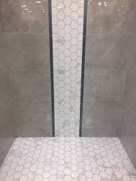Create a waterfall accent in your shower that flows right into the