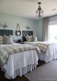 View In Gallery Country Guest Room With Rustic Wood Head Boards On Twin Beds