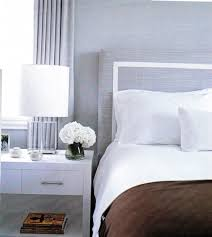 Chic Bedroom Design With Gray Linen Headboard White Border Piping Crisp Nightstands And Glass Lamps Brown Elle Decor