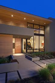 slate tile entry exterior modern with wood front door san