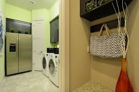 contemporary laundry room with sandstone tile floors by pillar