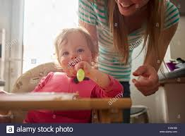 Toddler Sitting In Highchair, Eating Meal, Mother Standing ... Safety First Timba Highchair White High Chairs Strolleria Ikea Chair With Standing Laptop Station Fniture Little Girl Standing Image Photo Free Trial Bigstock Handsome Artist Eyeglasses Gallery Amazoncom Floorstanding High Bracket Bar Lift Modern Girl Naked On A Chair Stand In The Bathroom Tower Or Learning Made Splendid Office Desks Amusing Solar Cantilever Leander Free Worth Vitra Rookie