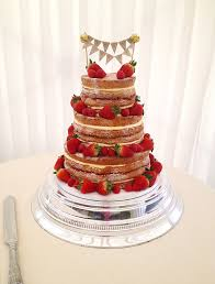 Naked Wedding Cake With Strawberries And Bunting
