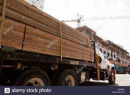 Lumber Truck At Construction Site Stock Photo: 59696706 - Alamy The First Sherwood Lumber Trucks Fiery Wreck Hurts Two After Lumber Truck Blows Tire On I81 North In Lumber At Cstruction Site Stock Photo 596706 Alamy Delivery Service 2 Building Supplies Windows Doors Truck Highway With Cargo 124910270 Piggy Back Logging Trucks Transport Forestry Wood Industry Fort Worth Loading Check And Youtube Flatbed Stock Photo Image Of Hauling Industry 79874624 Jeons Leslie Jenson Fine Art