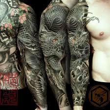 Full Sleeve Tattoo Is Completed With A Black Dragon Representing His Strength Against Obstacles
