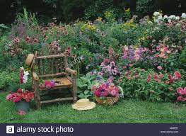Romantic Garden Rustic Chair In Home Flower Of Pinks And Reds With 2 Hats