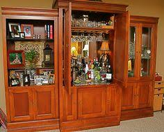 repurposed entertainment center as a bar www chefbrandy com