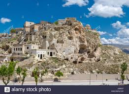 Landscape View Of Famous Historical Wish Hill With Sandstone Caves And Limestone Buildings On Bright Blue Sky Background