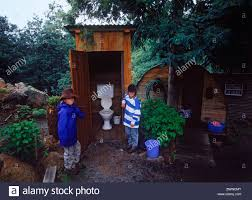 Kids Standing Next To Old Family Wooden Dunny Or Outhouse In ... Barns Outhouse Plans Pdf Pictures Of Outhouses Country Cool Design For Your Inspiration Outhousepotting Shed Coop Build Backyard Chickens Free Backyard Garden Shed Isometric Plan Images Cottage Backyard Kiosk Thouse Exchange Door Nyc Sliding Designs Fresh Awning Outdoor Shower At The Mountain Cabin Eccotemp L5 Tankless Water Keter Manor Large 4 X 6 Ft Resin Storage In Mountains Northern Norway Dunnys Victorian And Yard Two Up Two Down Terrace House