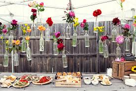 Cheap And Creative Garden Wedding Decoration Ideas Colorful Flowers In Hanging Glass Bottles For