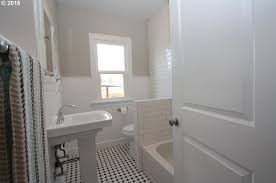 traditional bathroom with wainscoting tile floors in