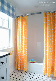 Curved Shower Rail with Orange Curtains Contemporary Bathroom