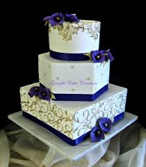 Elegant Ivory And Gold Wedding Cake With Purple Calla Lilies