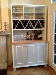 Make Liquor Cabinet Ideas by Zigzag Shaped Wine Racks With Multi Purposes Kitchen Wall Storage