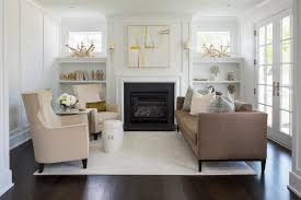 fireplace with built in shelves below windows transitional