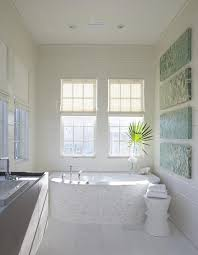 Tiling A Bathtub Deck by Curved Bathtub Clad In White Mosaic Marble Tiles Cottage Bathroom