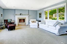 light blue living room with white sofa armchair and leather