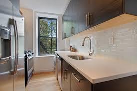 2x8 subway tile backsplash kitchen with flush hardwood floors zillow digs zillow