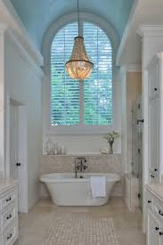 Mini Chandelier Over Bathtub by Chandelier Over Bathtub Stunning A Bathroom Featuring An Bathtub