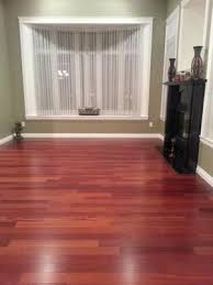 Red Cherry Wood Hardwood Floor Black Fireplace Green Walls