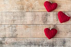 Stock Photo Three Knitted Red Hearts On Wooden Rustic Background For Valentines Day