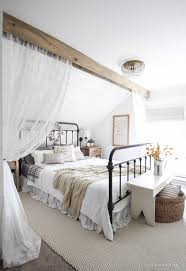 A Beautiful Farmhouse Bedroom Decorated With Simple Touches Of Fall