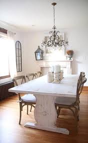 Hang A Crystal Chandelier Above Your Farmhouse Dining Room Table For Charming Southern Country Look