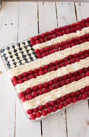 Flag cake white cake with a light whipped cream frosting berries and buttercream stripes