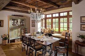 Farmhouse Style Dining Room Chandeliers Light Wood Flooring Comfy Window Seat Rustic Island Chairs And Cabinets