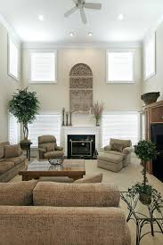 decorating living room with fireplace bookcases and windows tv