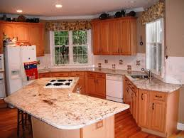 floratta white granite for light wood cabinets traditional