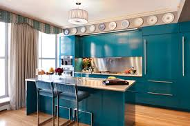Blue Painted Kitchen Cabinet With Stainless Steel Backsplash And Island Under Mounted Sink