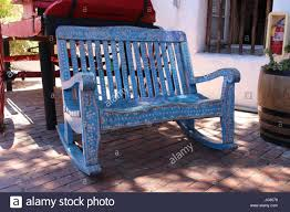 A Hand Crafted Mexican Bench Old Wood Carved And Painted Rustic Town Market San Diego California USA