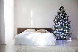Bedroom With Christmas New Year Tree Decoration Bed Stock Photo