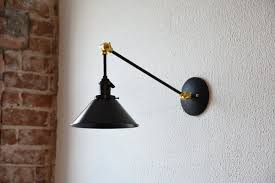 black and brass gold articulating boom wall sconce metal shade