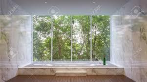 die badezimmer sind mit weißem marmor dekoriert es gibt große fenster um die natur hautnah zu erleben