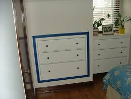 space saving three drawer chest inset into plasterboard wall