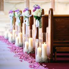 Wedding Church Candles Enchanted Garden Theme Purple And White Blooms Hung From The Ends Of