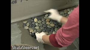 Sliced Pebble Tile Canada by Pebble Tile Shower Installation On Diy Network Youtube